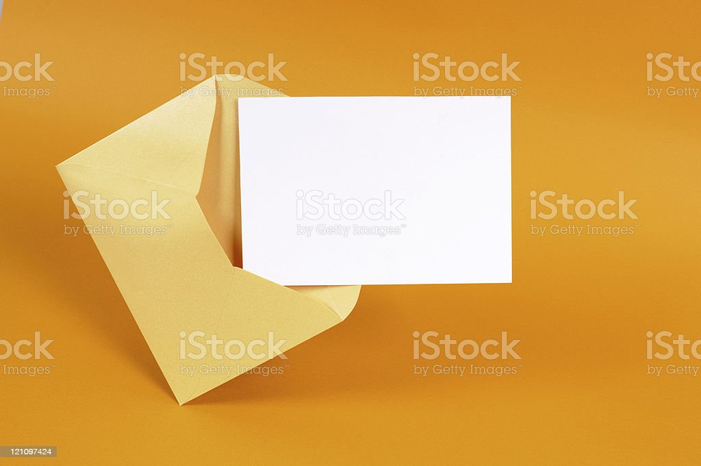 Gold envelope with blank message card stock photo
