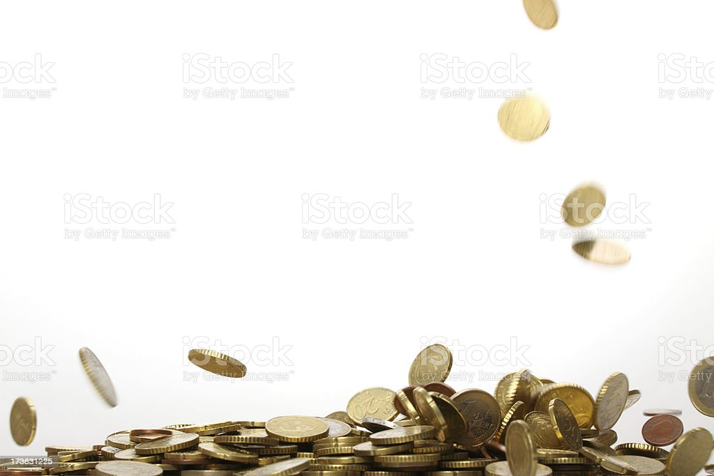 Gold euro coins falling and forming a pile  stock photo