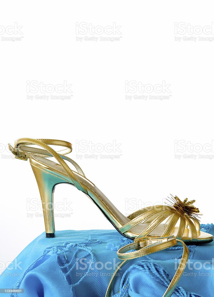 Gold evening shoes royalty-free stock photo