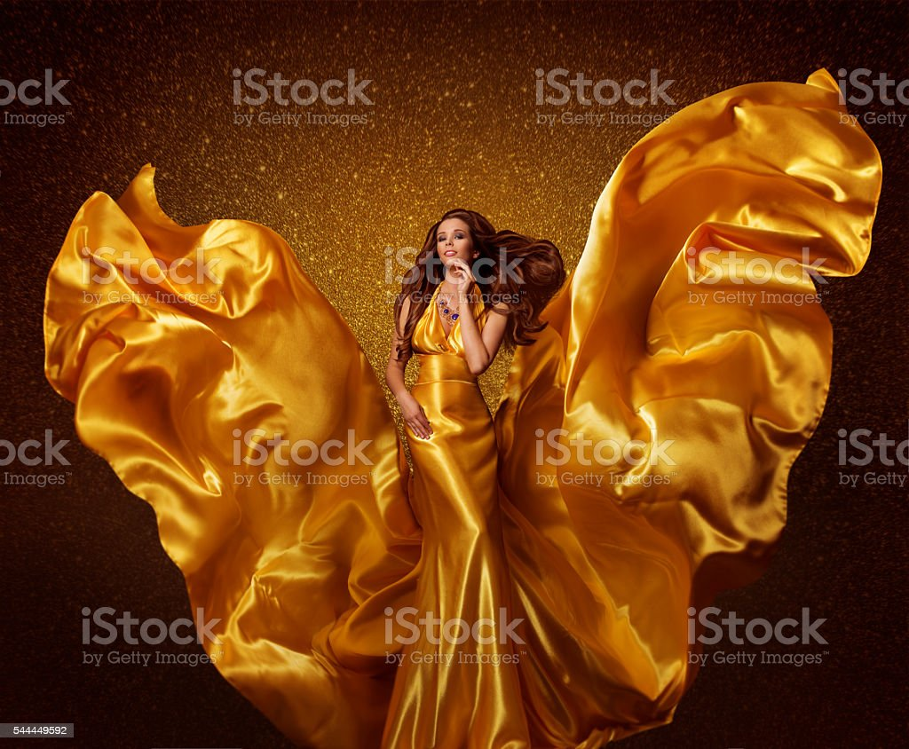 Gold Fashion Model Woman, Silk Fabric Flying Wind, Golden Wings stock photo