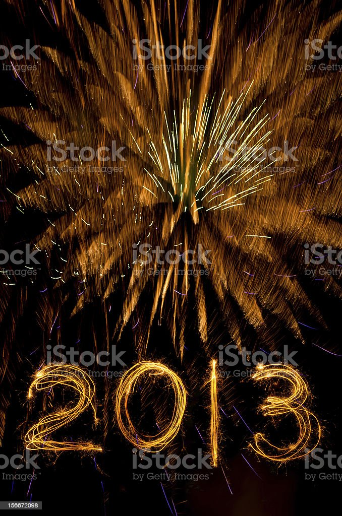 Gold fireworks and 2013 in sparkler writing royalty-free stock photo