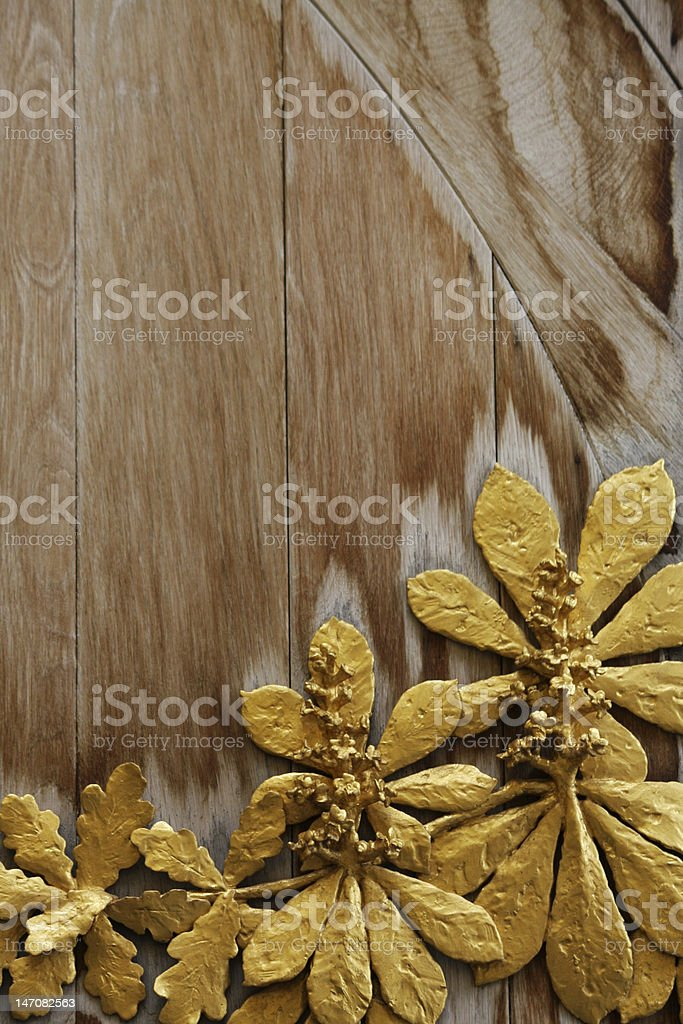 Gold Flowers on Wood royalty-free stock photo