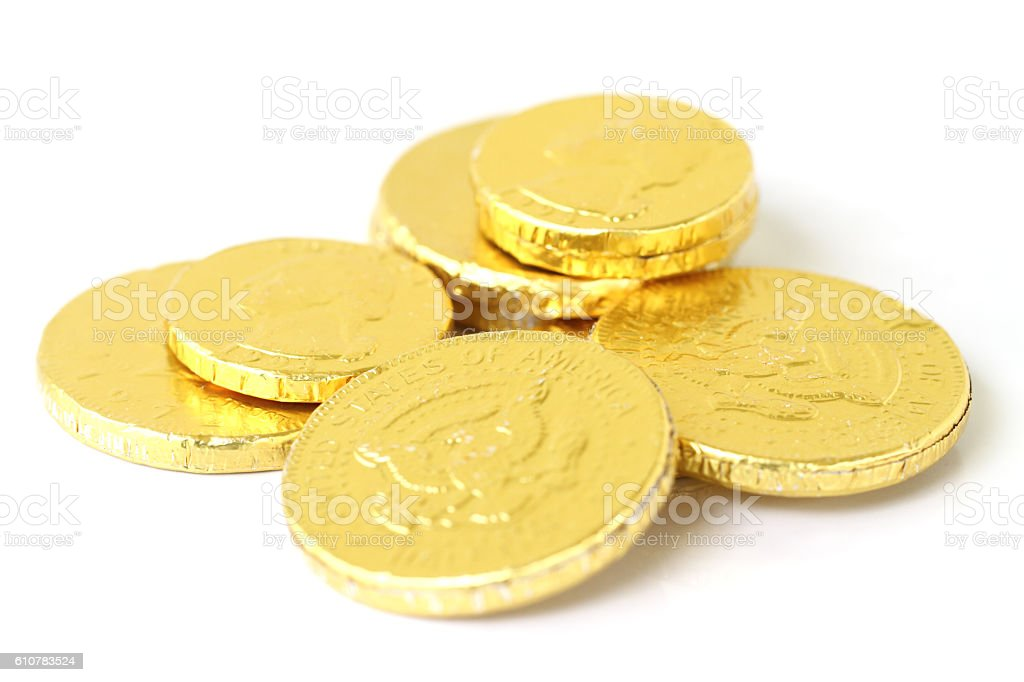 Gold foil covered chocolate coins stock photo