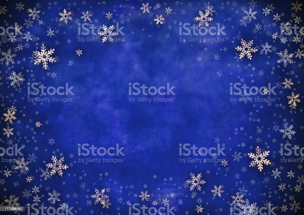 Gold foil snowflake winter background stock photo