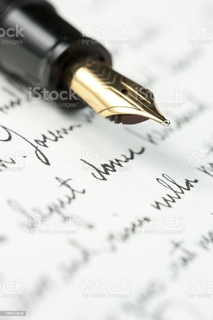 Gold fountain pen on hand written letter royalty-free stock photo
