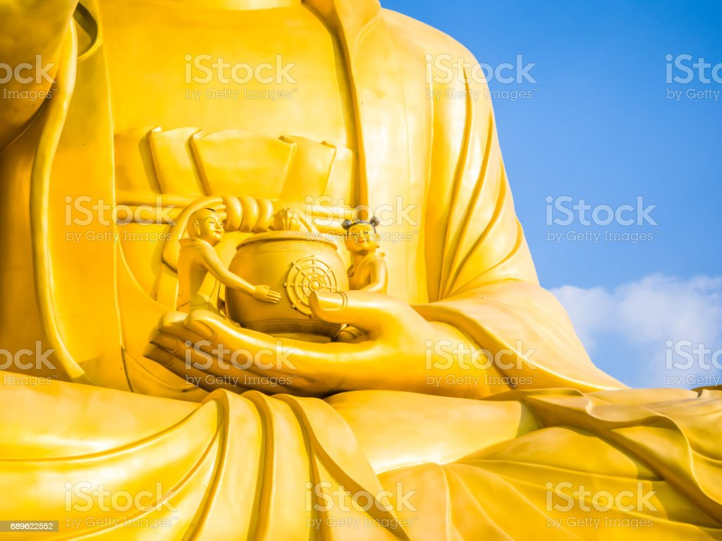 Gold Giant Buddha, Main Buddha Statue at Sanbanggulsa Temple, Sanbanggulsa is in Jeju-Do, Jeju Island in South Korea stock photo