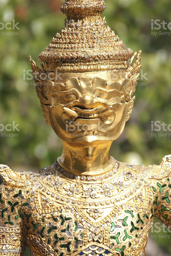 Gold giants face at Wat Phra Keow Thailand close up royalty-free stock photo