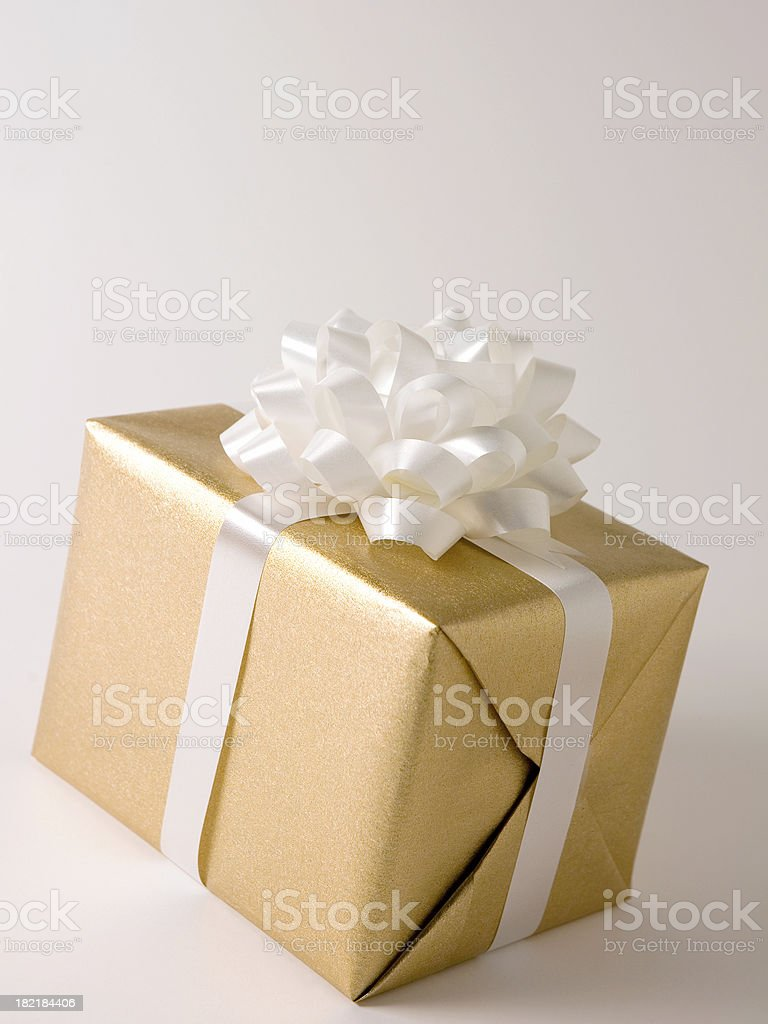 Gold Gift Box with White Ribbon Bow stock photo