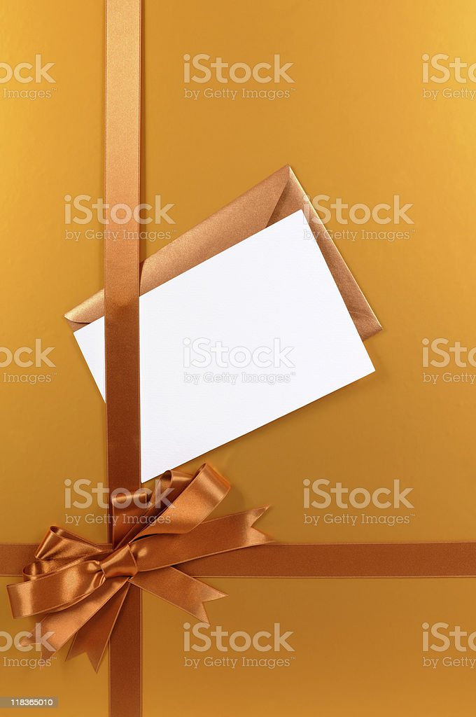 Gold gift with blank greetings card royalty-free stock photo