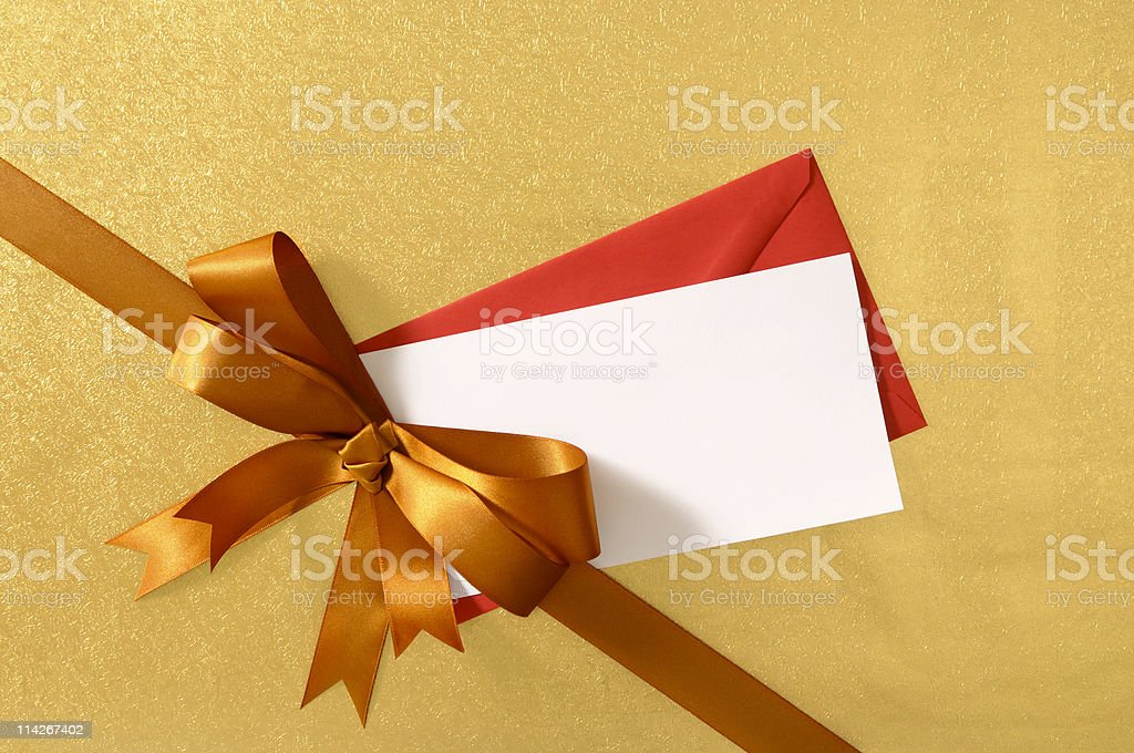 Gold gift with ribbon royalty-free stock photo