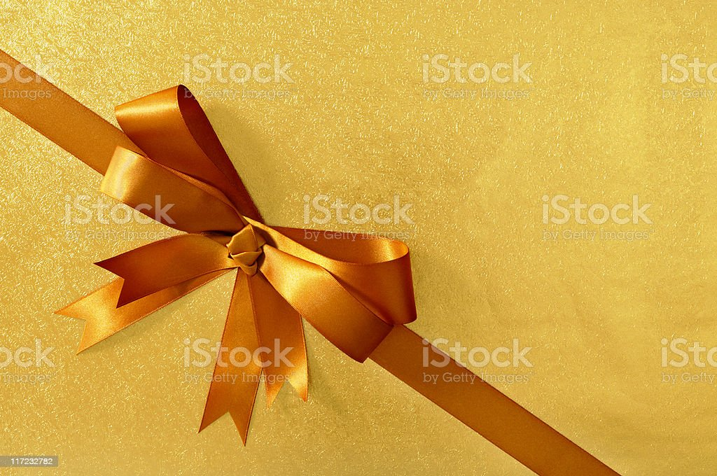 Gold gift with ribbon stock photo