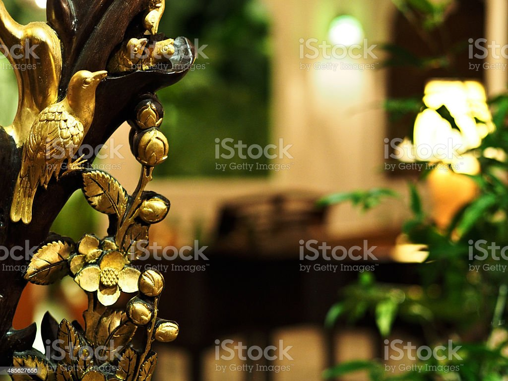 Gold gilded woodcarving of birds and flowers stock photo