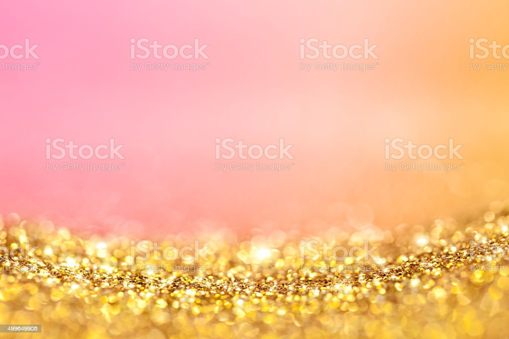 Gold glitter and pink orange background stock photo