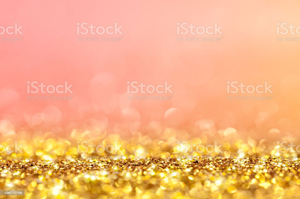 Gold glitter and red orange background stock photo
