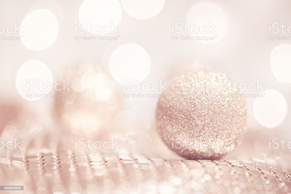 Gold Glitter Ball with Pink Bokeh Background stock photo