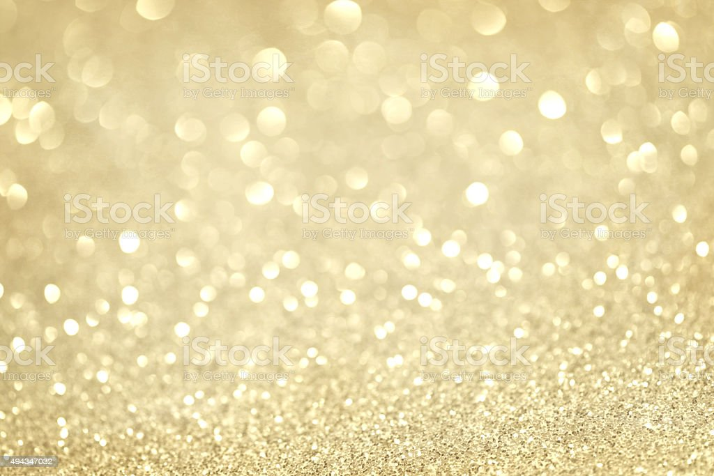 gold glittering christmas lights. Blurred abstract background stock photo
