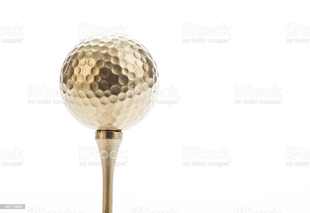 Gold Golf Ball and Tee on White Background stock photo
