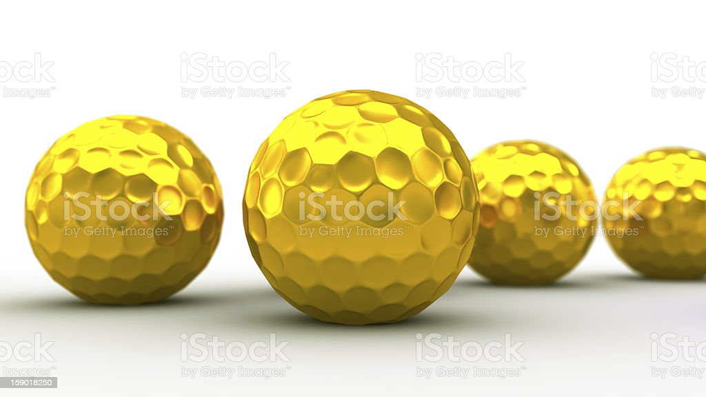 Gold golf balls. royalty-free stock photo