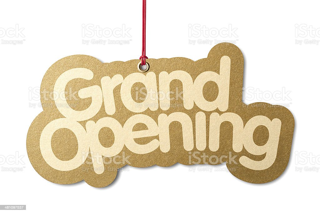 Gold GRAND OPENING hanging from red cord stock photo