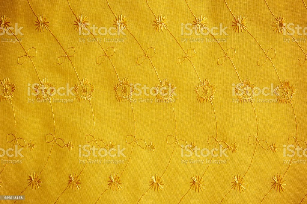 gold guipure, embroidery on cloth for wedding dress, texture stock photo