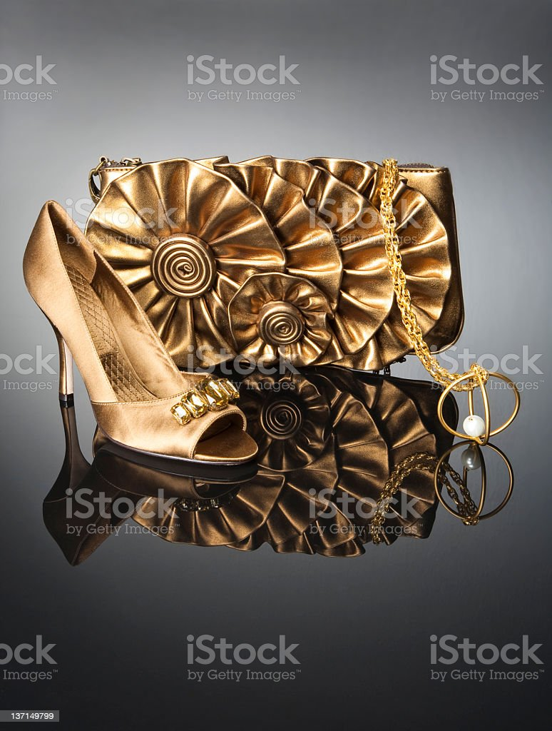 Gold handbag with shoe stock photo
