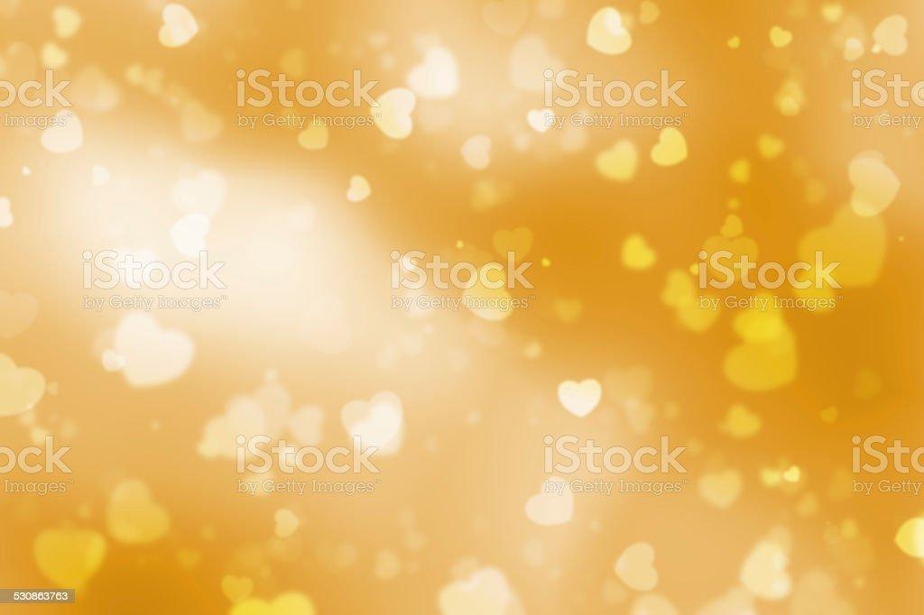 Gold heart shaped bokeh background stock photo