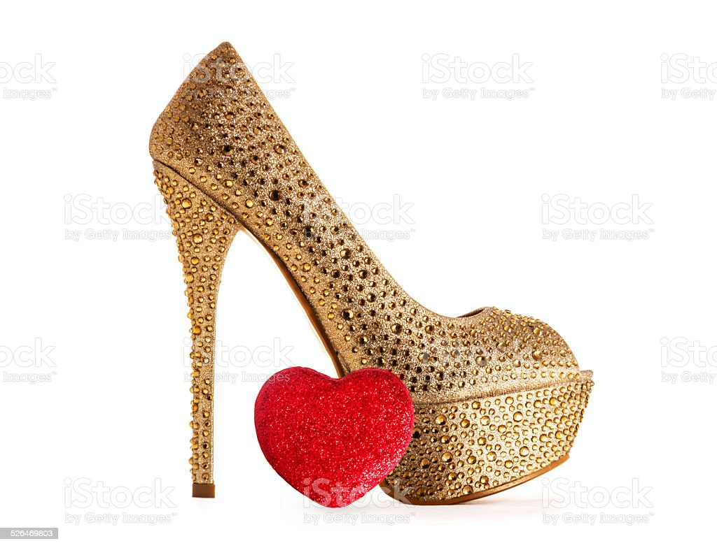 Gold high heel sparkling and brilliant sexy shoe stock photo