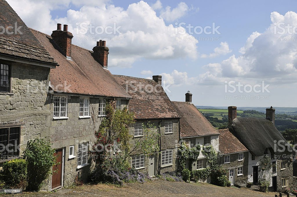 Gold Hill in Shaftesbury, England under a warm blue sky stock photo