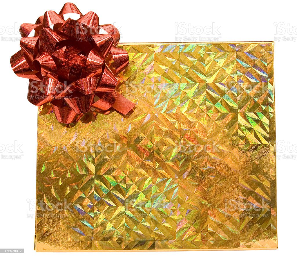 Gold holographic box with red bow royalty-free stock photo