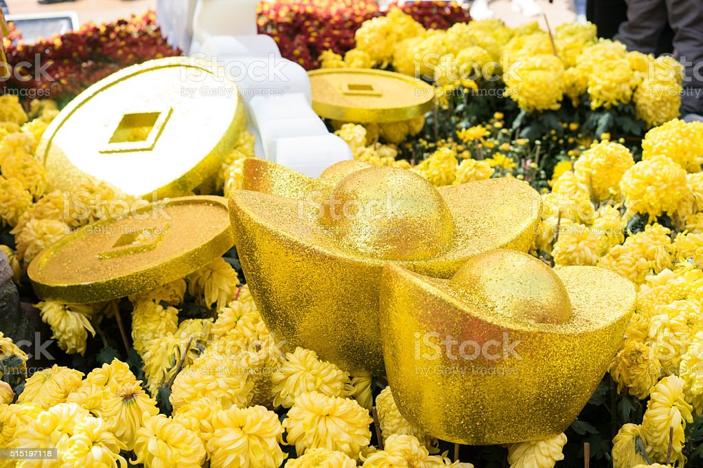 gold ingot decoration and chrysanthemum stock photo