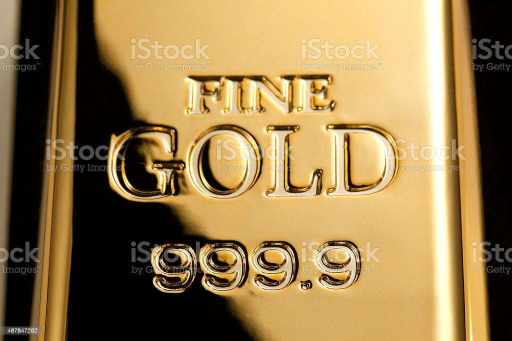 Gold ingot stock photo