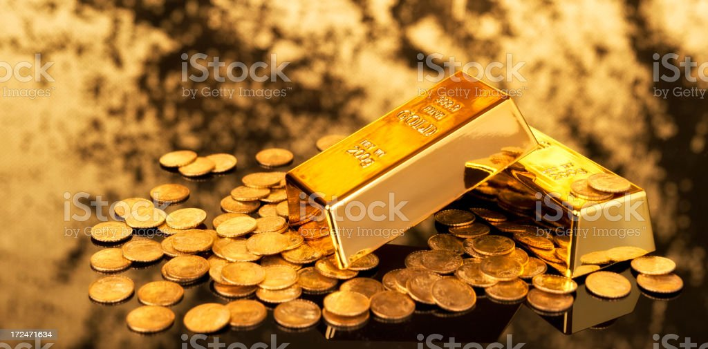 Gold ingots and coins stock photo