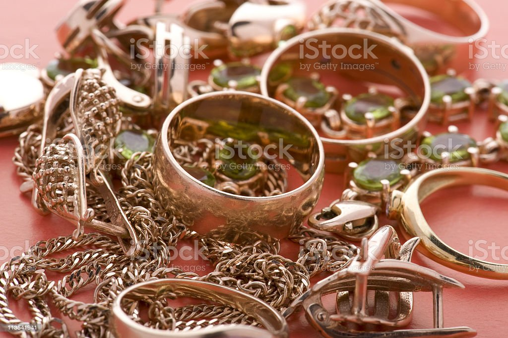 Gold jewel on red close up royalty-free stock photo