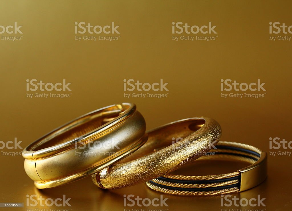 gold jewelry, bracelets royalty-free stock photo