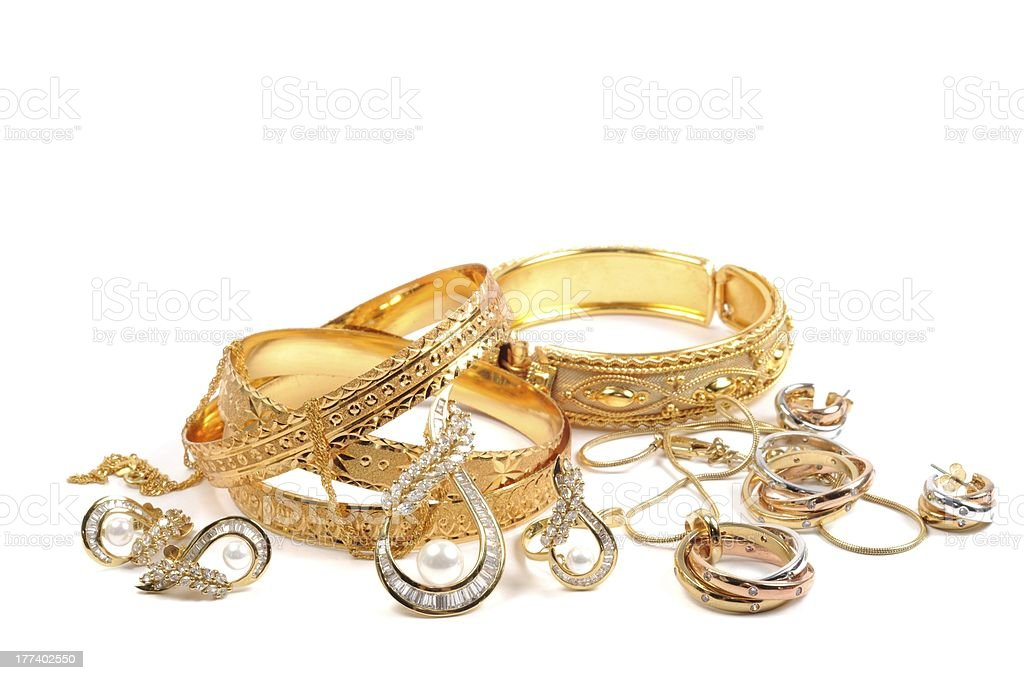 Gold jewelry laying in a small pile stock photo
