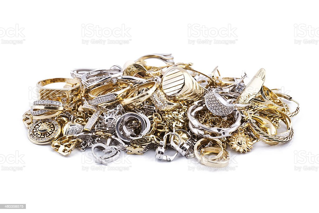 Gold jewelry on a white background stock photo