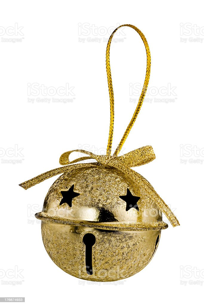 A gold jingle bell tied with a golden bow stock photo