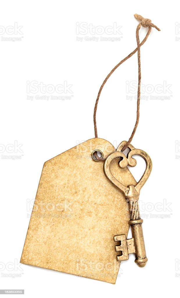 Gold key and tag stock photo