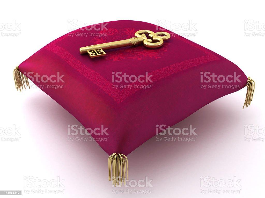 Gold key on the oriental velvet pillow stock photo