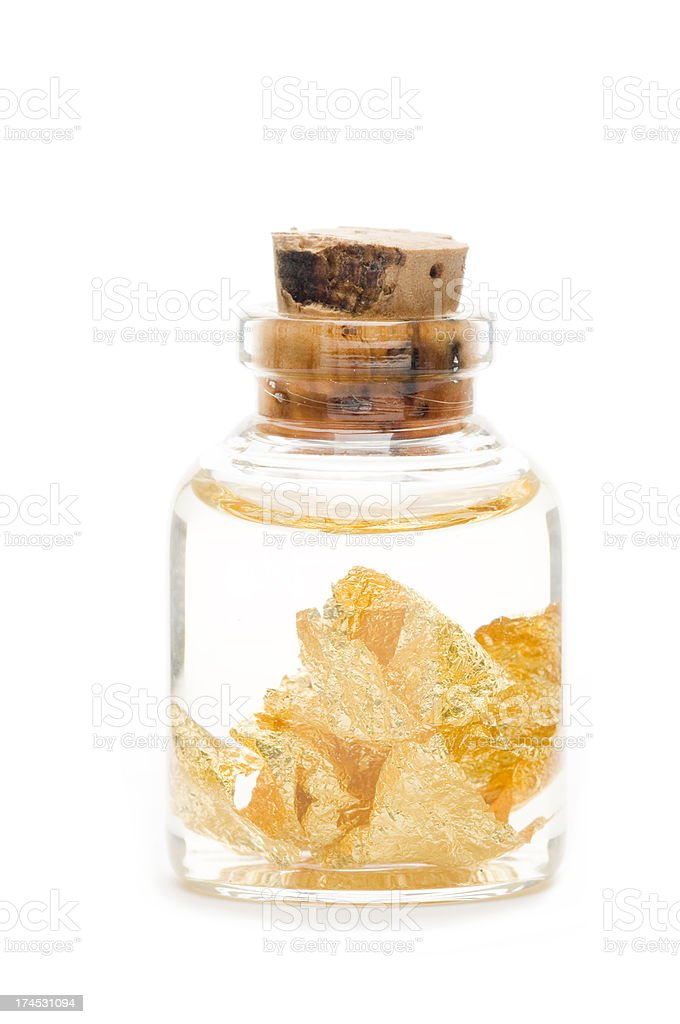 Gold leaf in a bottle royalty-free stock photo