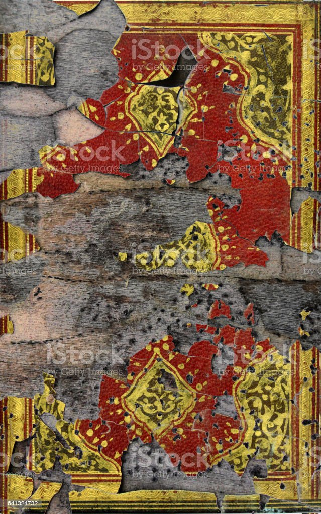 Gold leaf ornaments painted on a grunge plank stock photo