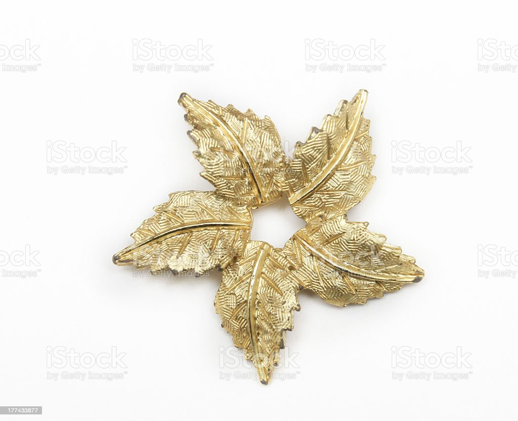 Gold Leaf Vintage Pin on White Background stock photo