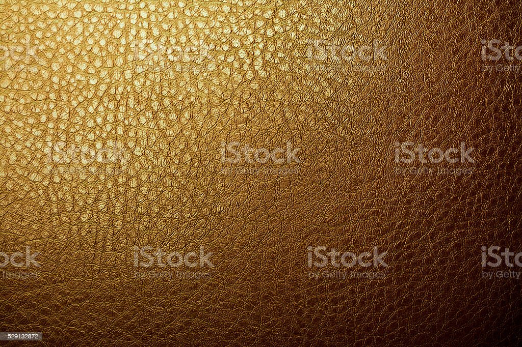 Gold leather material texture background stock photo
