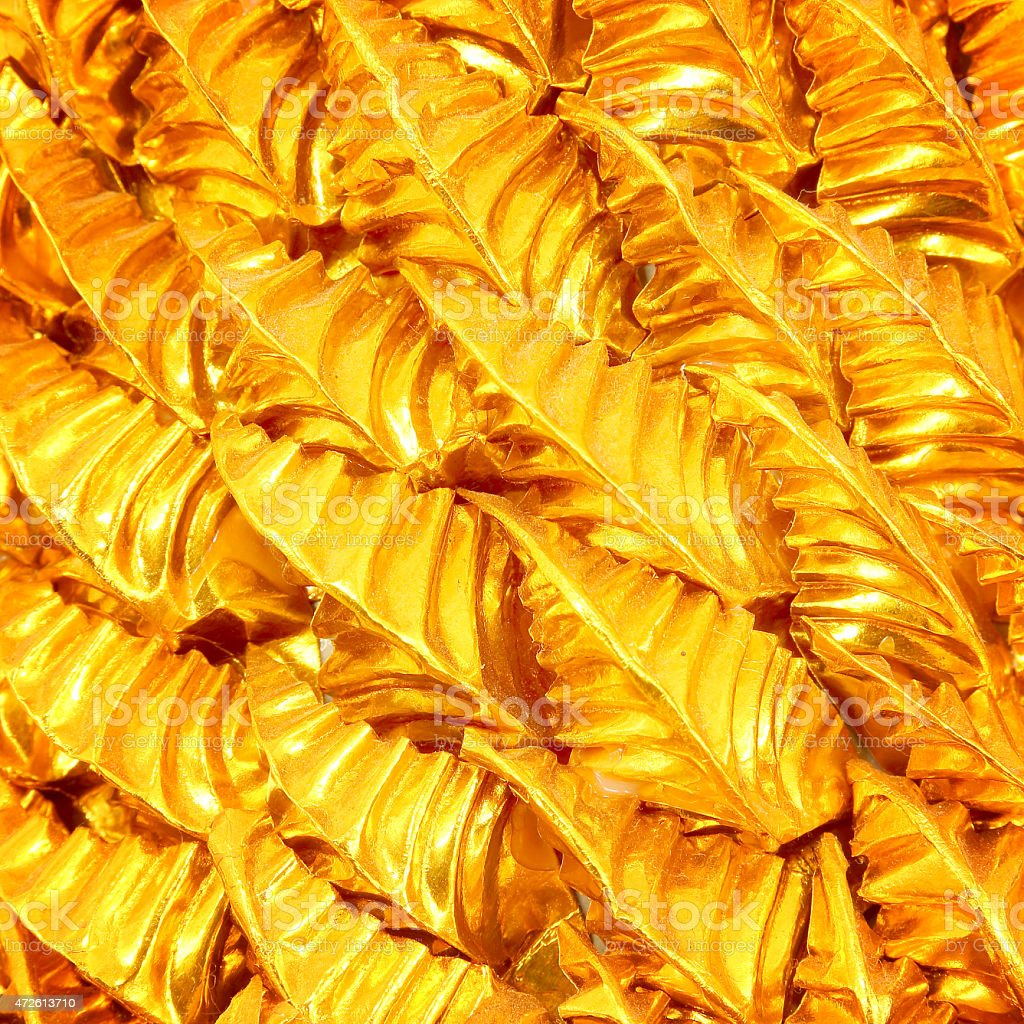 Gold leaves foil wonderful metallic background stock photo
