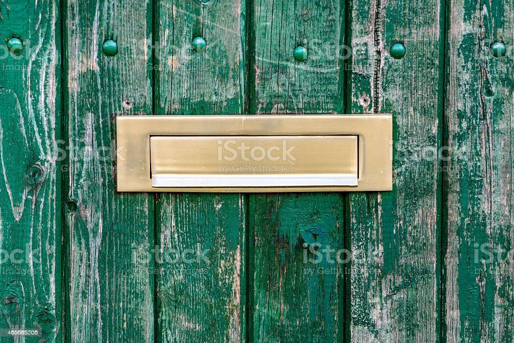 gold Letterbox  in door stock photo