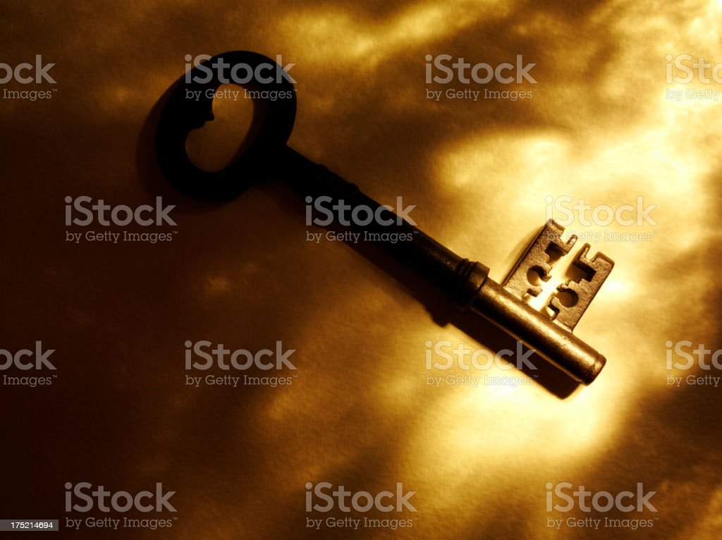 Gold Lighting on a Old Church Key royalty-free stock photo