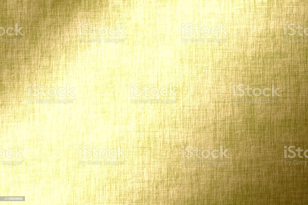 Gold luminous background, golden fabric texture, wrapping paper stock photo