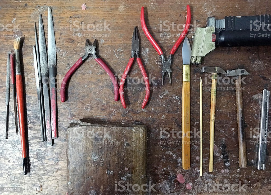 Gold maker tools on the wood table with trail stock photo