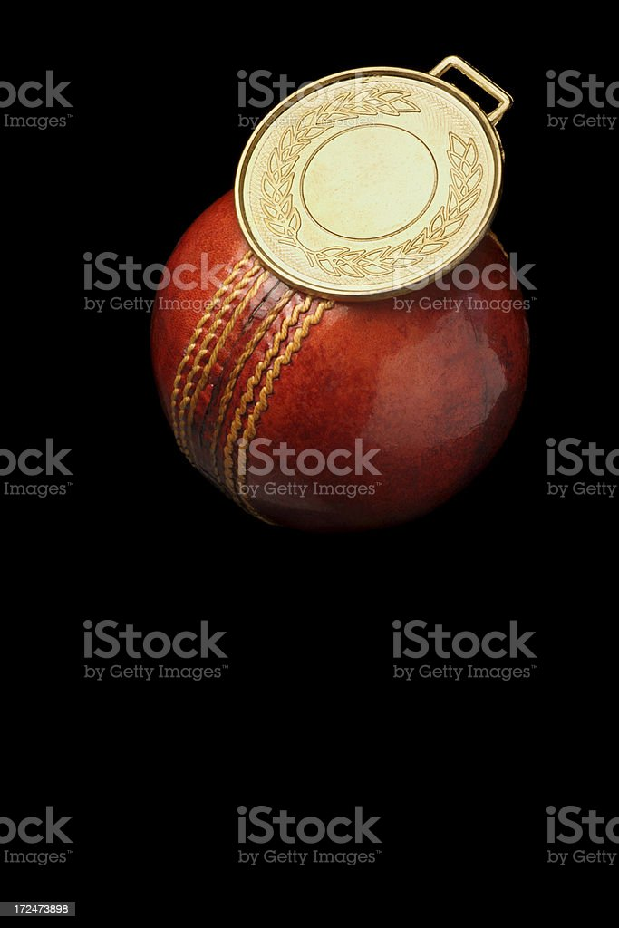 Gold medal and cricket ball royalty-free stock photo