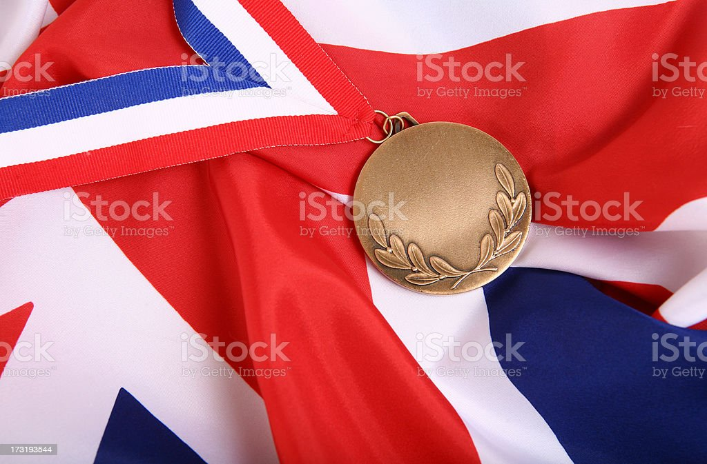Gold Medal and UK Flag royalty-free stock photo
